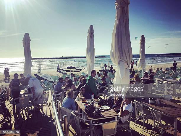 People relaxing in beach cafe, Tel Aviv, Israel