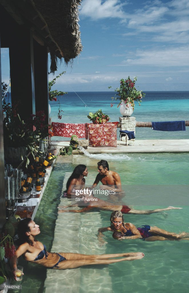 People relaxing in the bar at Plantation Cocoyer, Cocoyer Beach, Haiti, February 1981.