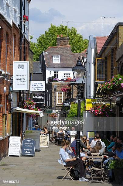 People relaxing outside cafes in Perrins Court Hampstead