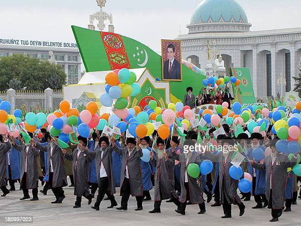 People release ballons during a military parade marking Turkmenistan's Independence Day in Ashgabat on October 27 2013 AFP PHOTO / STR