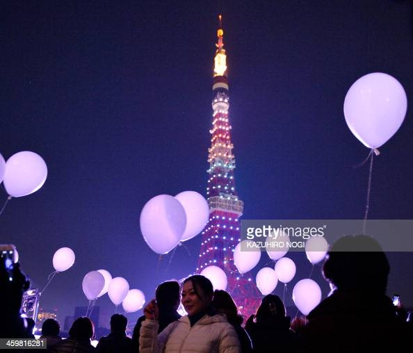People release balloons to celebrate the New Year during the annual countdown ceremony by the Prince Park Tower Tokyo on January 1 2014 Some 2000...