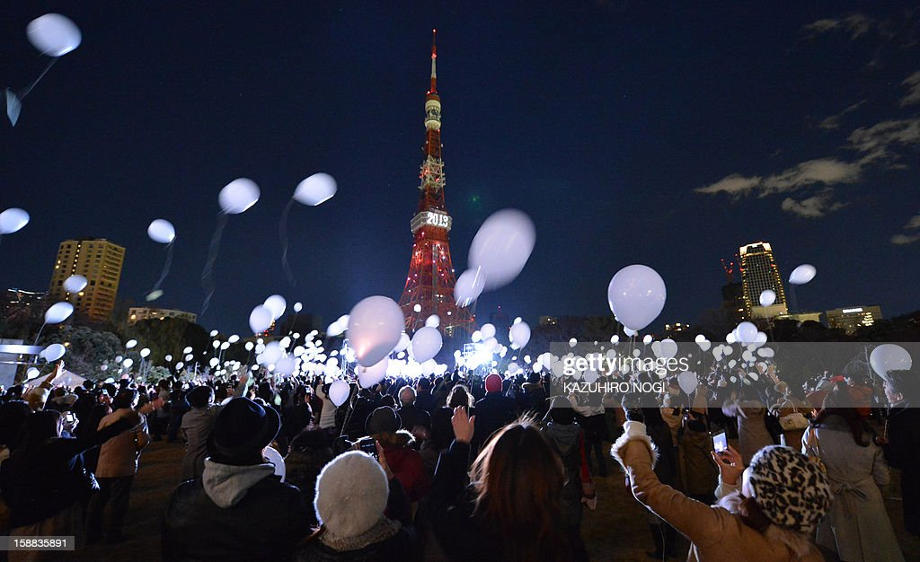 People release balloons to celebrate the New Year's during an annual countdown ceremony produced by the Prince Park Tower Tokyo, flagship of the Prince hotel chain in Tokyo on January 1, 2013. Some 1,000 balloons were released in the air with the visitors wishes.
