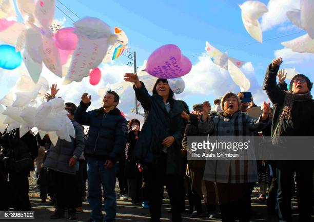People release doveshaped balloons at Yuriage area on the sixth anniversary of the Great East Japan Earthquake and following tsunami on March 11 2017...