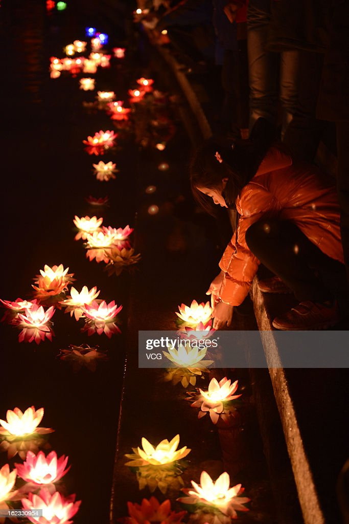 People release floating lanterns onto a river to celebrate the Spring Festival on February 21, 2013 in Rizhao, China. The Chinese Lunar New Year of Snake also known as the Spring Festival, which is based on the Lunisolar Chinese calendar, is celebrated from the first day of the first month of the lunar year and ends with Lantern Festival on the Fifteenth day.