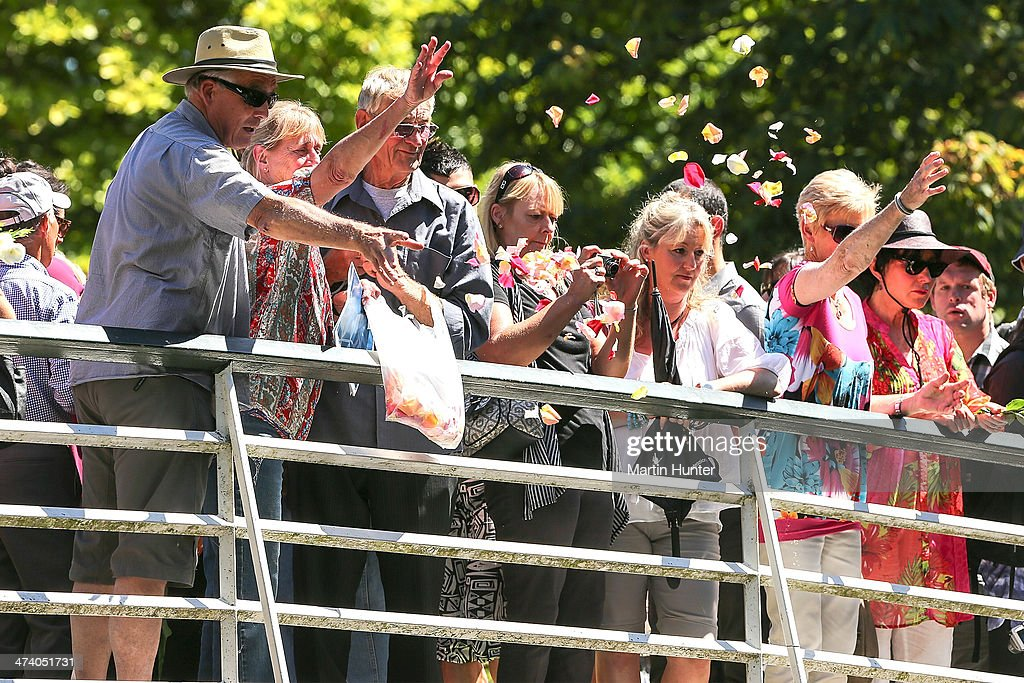 People release flowers into the Avon River as remembrance during a Civic Memorial Service held in the Botanical Gardens for victims of the 2011 Christchurch Earthquakes on February 22, 2014 in Christchurch, New Zealand. The earthquake measuring 6.3 in magnistude devastated Christchurch killing 185 people and causing an estimated $40 billion in damage to the city's buildings and infrastructure.