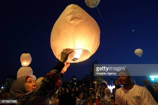 People release sky lanterns up to sky during an event celebrating the anniversary of end of the Lebanese civil war in Beirut Lebanon on April 29 2017...