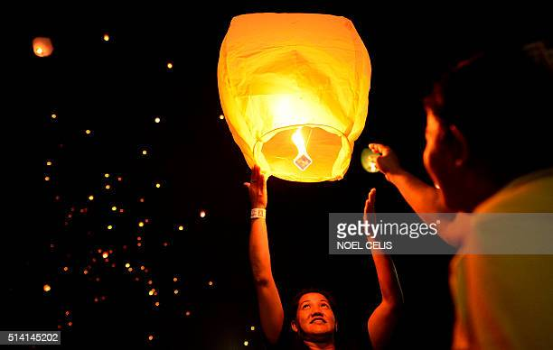 People release skylanterns on the eve of International Women's Day in Manila on March 7 2016 The event calls for the end of all forms of...