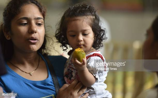 People relish the mangoes during the 29th Mango Festival at Dilli Haat at Janak Puri on June 30 2017 in New Delhi India 500 Varieties of mangoes are...