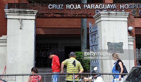 People remain at the entrance of the Red Cross Hospital where a 10yearold girl who was raped by her stepfather and is now five months pregnant is...