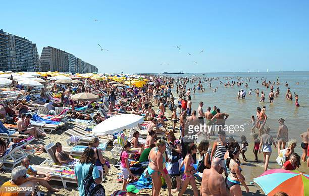 People remain on a crowded beach along the Belgian coast in Blankenberge on August 18 during a hot summer week end AFP PHOTO / BELGA / BENNY WOUTERS