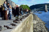 People remember at the 'Shoes statue of a memorial place of the Holocaust victims' on the bank of the Danube River in downtown of Budapest on April...