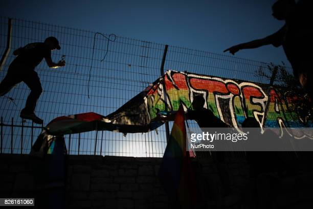 People remove a banner during the annual Gay Pride parade in Jerusalem Israel August 03 2017 22000 March in Jerusalem Pride Parade Jerusalem Under...