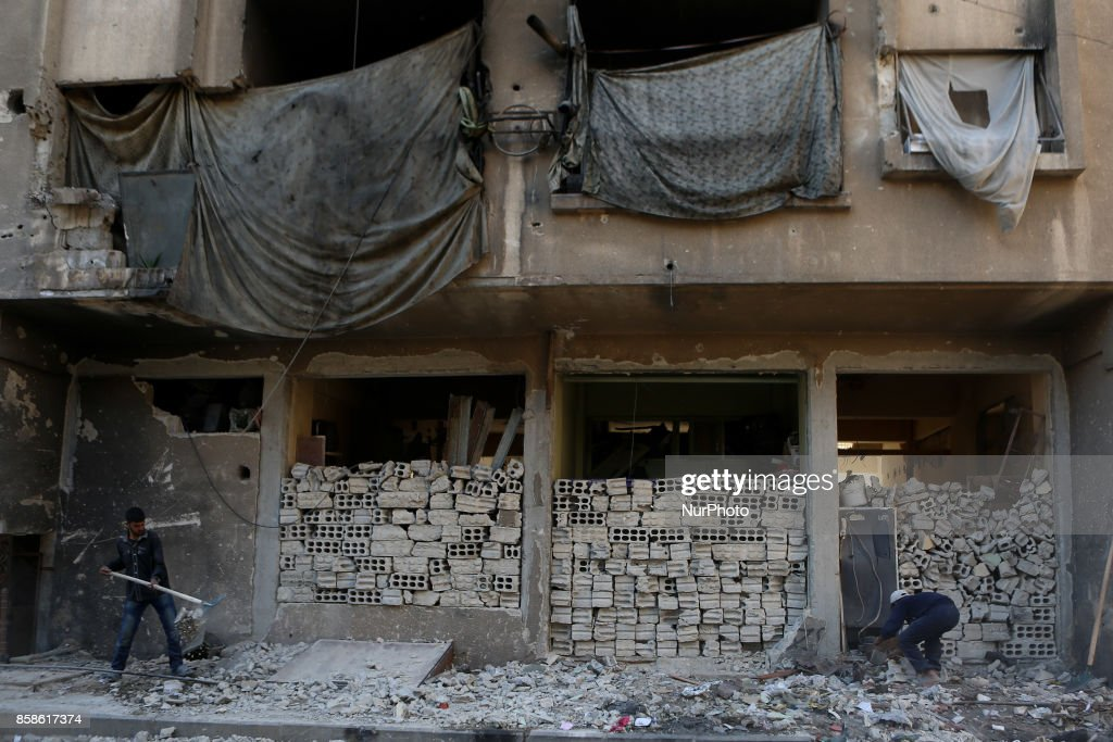 People remove rubble at thier destroyed house after airstrikes on rebel. held Douma Outskirts of Damascus, Syria, 7 October 2017. At least 4 people got killed and more than 50 people got injured from airstrikes on the rebel.
