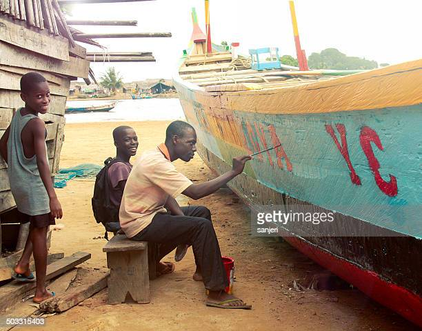 People renovating the fisherman boat