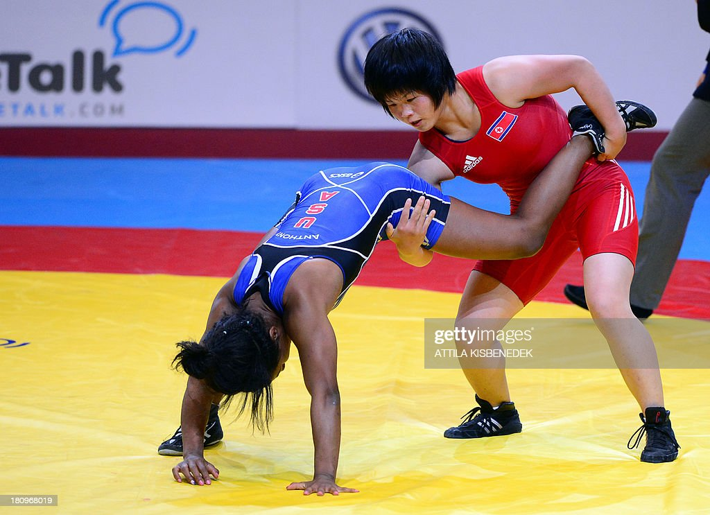 People Republic of Korea's Sim Hyang So (red) and U.S. Victoria Lacey Anthony (blue) fight for the bronze medal during the women's free style 51 kg category of the FILA World Wrestling Championships in Budapest on September 18, 2013. So won te bronze medal.