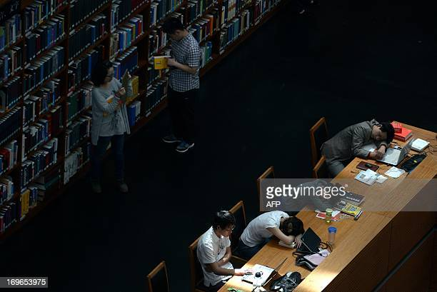 People rest and read books at a national library in Beijing on May 30 2013 China's ruling Communist Party has called for greater political...