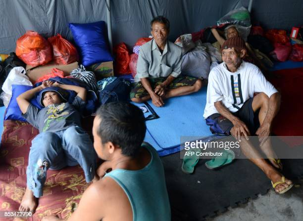 People rest at an evacuation centre in Klungkung regency on the Indonesian resort island of Bali on September 25 2017 Authorities have raised alert...