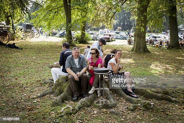 People rest in the nearby forest as they attend the first edition of the Chantilly Arts and Elegance Richard Mille event on September 7 2014 at the...