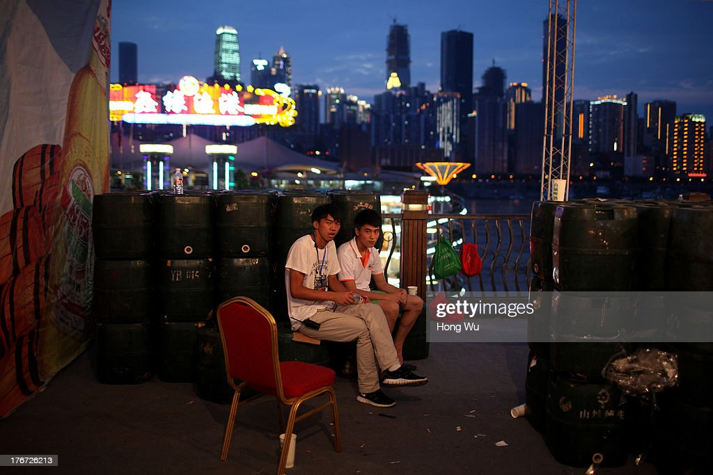 People rest in the night on August 4, 2013 in Chongqing, China. Chongqing is a major city in southwest China and became the municipality was created on 14 March 1997. It known as a 'Mountain City' and 'River City' was constructed on the mountain and along the Yangtze River.