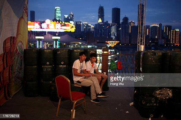 People rest in the night on August 4 2013 in Chongqing China Chongqing is a major city in southwest China and became the municipality was created on...