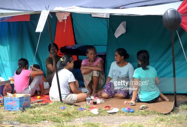 People rest inside a temporary evacuation centre at Ulakan village in the Manggis subdistrict in Karangasem Regency where Mount Agung is located on...