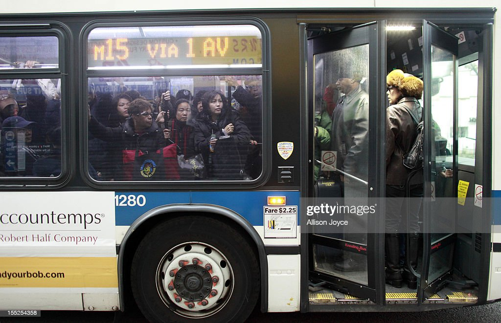People ride a crowded bus November 2, 2012 in New York City. Limited public transit has returned to New York. With the death toll continuing to rise and millions of homes and businesses without power, the U.S. east coast is attempting to recover from the effects of floods, fires and power outages brought on by Superstorm Sandy.