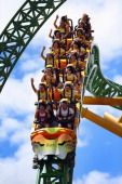 People ride a roller coaster at Busch Gardens Tampa Bay on July 12 2012 in Tampa Florida The park is expecting more business during the 2012...