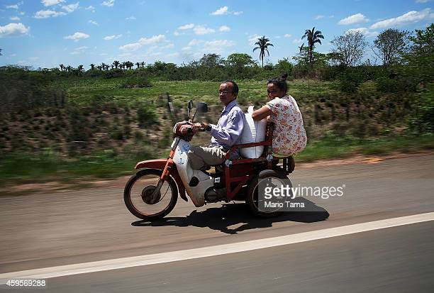 People ride a sccoter in a deforested section of the Amazon basin on November 24 2014 in Maranhao state Brazil The nongovernmental group Imazon...