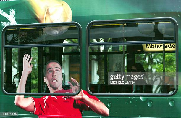 People ride a tram with a picture of Swiss football player Ricardo Cabanas painted on the coach on May 31 2008 in Zurich One could almost hear the...