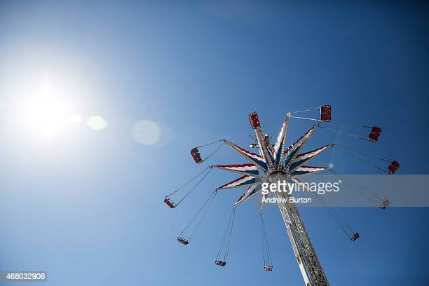 People ride amusement park rides at Coney Island on March 29 2015 in New York City Various Coney Island businesses including Luna Park opened for the...