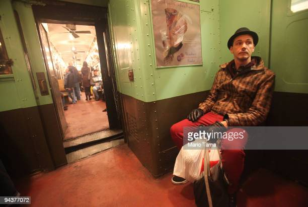 People ride an antique subway train during a 'Vintage Tea Party' hosted by Levy's Unique New York tour group December 13 2009 in New York City New...