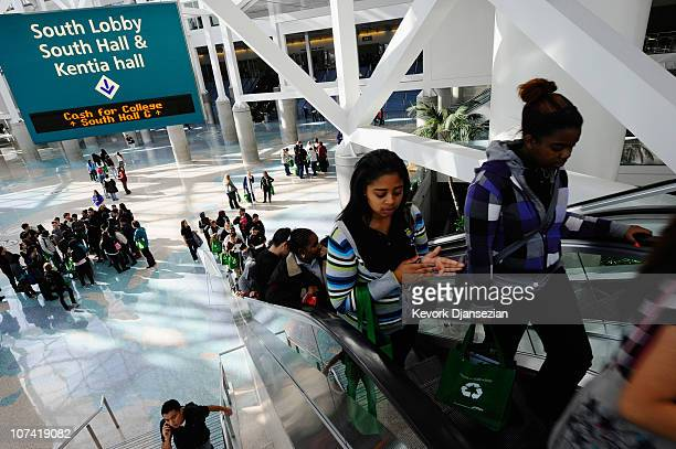 People ride an escalator as more than 15000 middle and high school students and their families from Los Angeles attend Cash for College a college and...