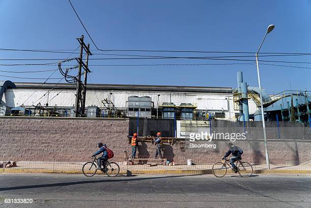 People ride bicycles in front of the General Motors Co assembly plant in Toluca de Lerdo Mexico on Saturday Jan 7 2017 Presidentelect Donald Trump...