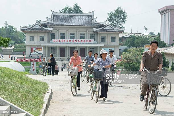 People ride bicycles on August 23 2015 in Pyongyang North Korea North and South Korea today came to an agreement to ease tensions following an...