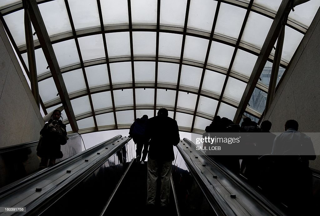 People ride escalators as they leave the Waterfront Metro Station in Washington, DC, on January 30, 2013. AFP PHOTO / Saul LOEB