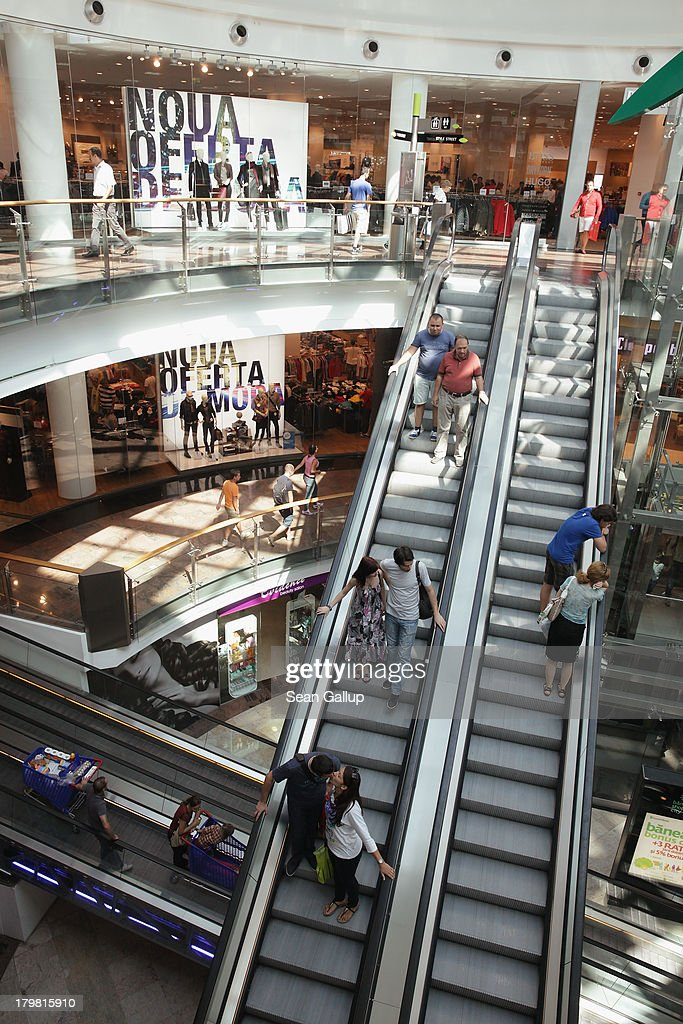 People ride escalators at a modern shopping mall on September 7, 2013 in Bucharest, Romania. While Romania's economic output has risen significantly since it joined the European Union in 2007, it still lags in infrastructure development and the fight against corruption.