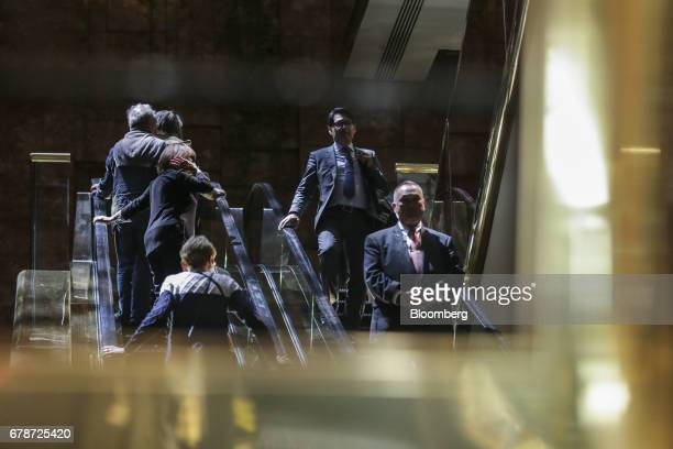 People ride escalators inside Trump Tower in New York US on Thursday May 4 2017 President Donald Trumpreturns Thursday with all the fanfare of the...