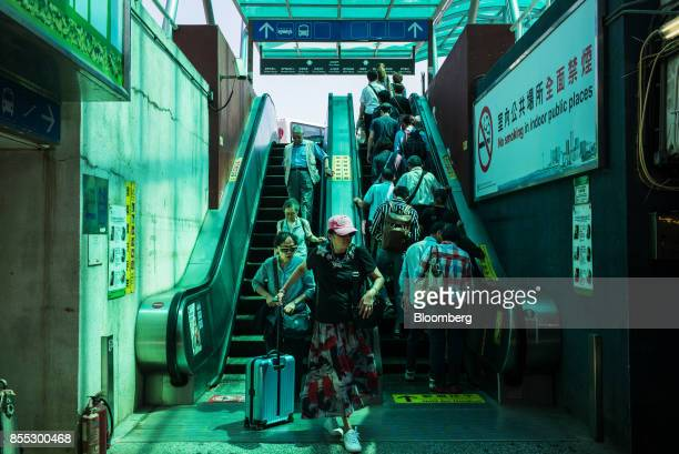 People ride escalators near the Macau Outer Harbour Ferry Terminal in Macau China on Wednesday Sept 27 2017 Junkets flush with high rollers full...