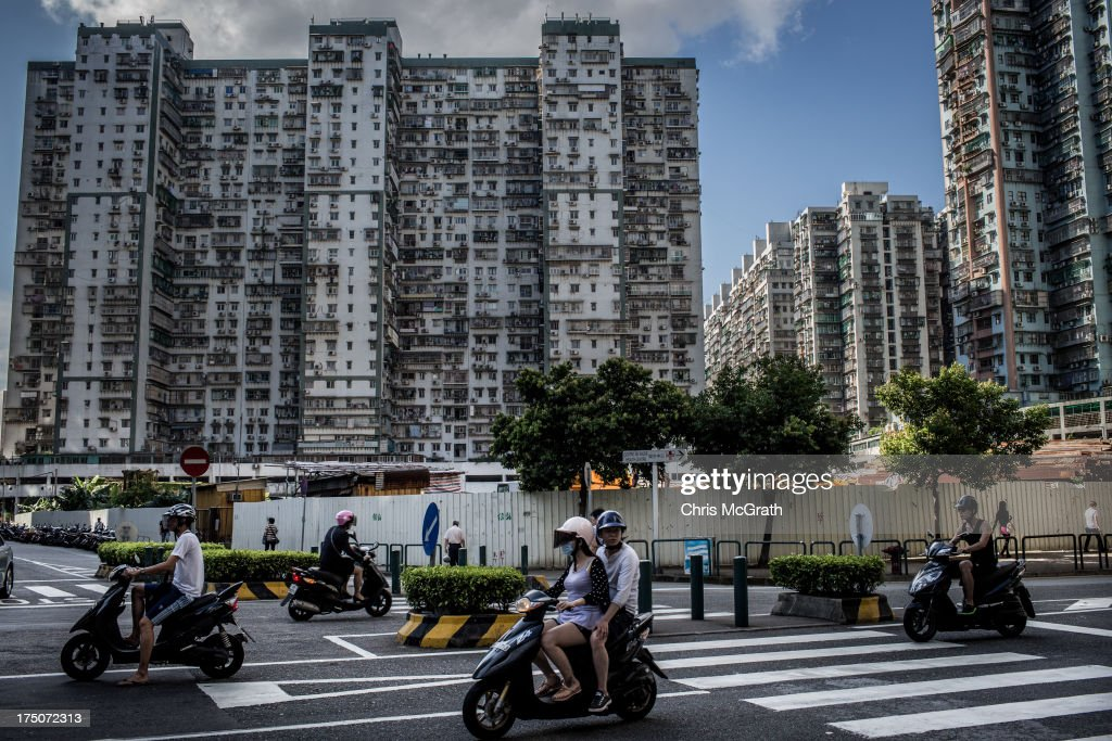 People ride mopeds through a busy intersection in the residential district on July 29, 2013 in Macau, Macau. Macau, the only place in China with legalized casino gambling is booming. Gambling has been legal in Macau for more than 150 years but has seen a rapid transformation over the last decade from the small time gambling clubs, gangs and prostitution of the 1990s, to becoming the worlds gambling mecca. Last year, Macau generated $38 billion in casino revenue, six times more than Las Vegas, Nevada. Situated just one hour from mainland China and Hong Kong, Macau also known as 'The Oriental Las Vegas ' received 14.1million visitors for the first six months of this year, in the most recent Statistics and Census Bureau report, with close to 90% of visitors being from mainland China, Taiwan and Hong Kong. Although the gambling industry has improved general living standards across Macau, it is not without it's downside. With the influx of big money also comes, higher living costs, with some residents saying issues such as transportation, health care and social welfare have largely been ignored. Property prices have increased dramatically, forcing many small and mid-sized businesses into bankruptcy and pushing some residents to share accommodation or move away completely.