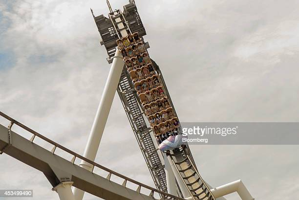 People ride on Hollywood Dream The Ride roller coaster at Universal Studios Japan operated by USJ Co in Osaka Japan on Thursday Aug 7 2014 USJ is...