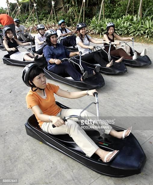 People ride on luges at Sentosa Island resort in Singapore 30 August 2005 The ride which costs eight Singapore dollars thrillseekers will ride down a...