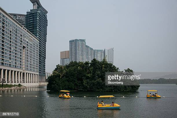 People ride on pedal boats at Nam Van Lake in Macau China on Sunday Aug 28 2016 Macau is scheduled to release gross domestic product figures on Aug...