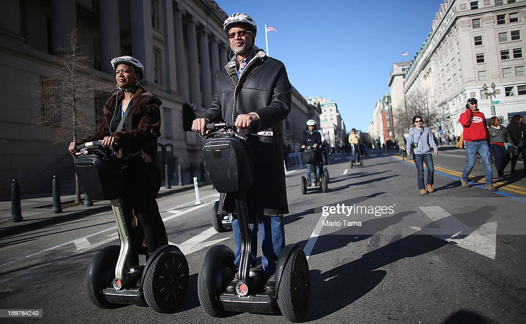 People ride Segways down a street closed for the inauguration during preparations for U.S. President Barack Obama's second inauguration on January 20, 2013 in Washington, DC. The U.S. capital is preparing for the second inauguration of U.S. President Barack Obama, which will take place on January 21.