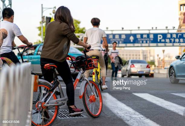 People ride shared bikes on city street In accordance with the current growth sharing bicycles in the Q2 quarter of 2017 will be expected to exceed...
