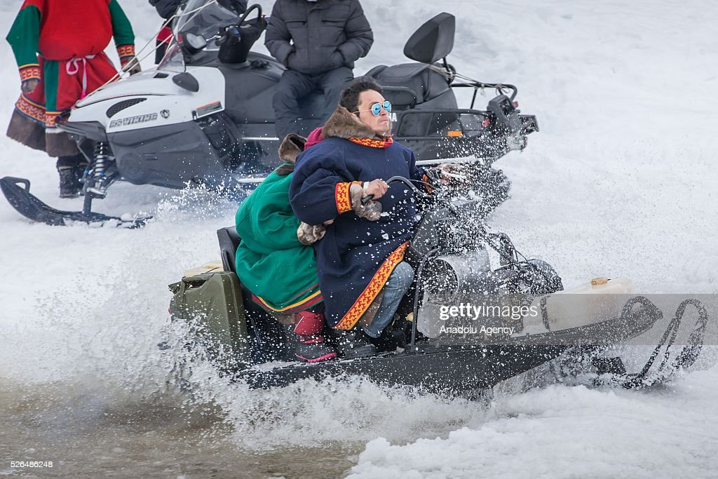 People ride snowmobile in melting snow at the north of Yamal Gyda, the northernmost settlement of the Yamalo-Nenets Autonomous Okrug in Russia on April 27, 2016. Effects of global warming are seen more clearly every year as north gets warmer and spring comes sooner. This situation makes residents and reindeer harders' life very difficult.
