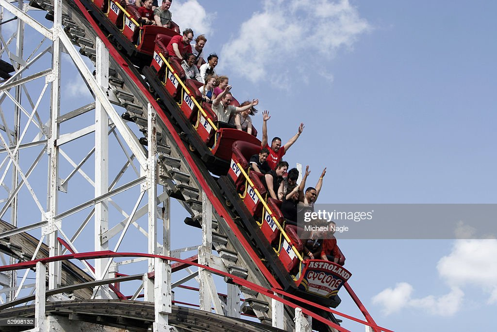 People ride the Cyclone roller coaster at Coney Island during the Memorial Day weekend on May 29, 2005 in Brooklyn, New York City. Warm and sunny weather lured hundreds of people to the shores and parks.