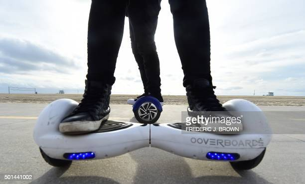 People ride their hoverboards on the Venice Beach Boardwalk California on December 10 2015 The hot item on many holiday lists will help you zip...