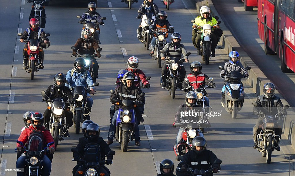 People ride their motorcycles along a freeway during Car Free day in Bogota, Colombia, on February 7, 2013. Residents of Bogota are asked not to use their cars in an attempt to reduce environmental pollution. AFP PHOTO/ Luis Acosta