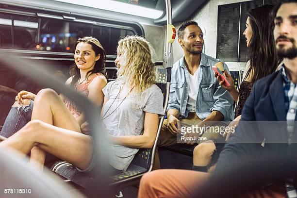 People Riding City Metro Bus