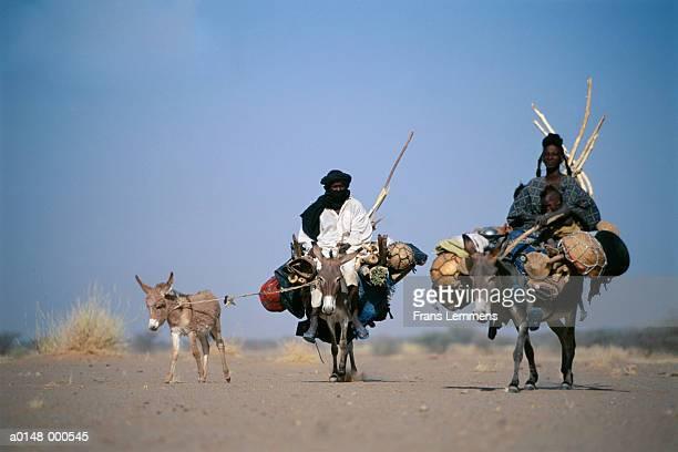 People Riding Donkeys